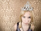 pic of spoiled brat  - Portrait of pretty pouting young girl wearing a tiara - JPG