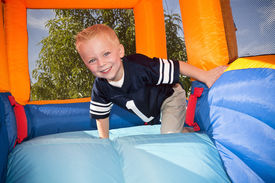 image of inflatable slide  - Boy playing on and inflatable Side - JPG