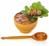cloudberry jam bowlwith fresh berry close up isolated on white background