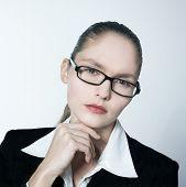 studio shot portrait of one caucasian young serious business woman