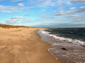 stock photo of cape-cod  - The off season on Hardings at Chatham Massachusetts with sand waves and clouds - JPG