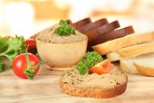 Composition of fresh pate, tomatoes and bread, on bright background