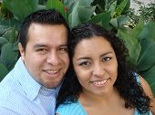 Close Up Of Faces Of Young Hispanic Couple