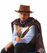 foto of gunslinger  - Bad gunslinger  in the old wild west on white background - JPG