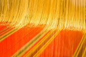 Close-up Of A Loom Weaving Golden Fabric