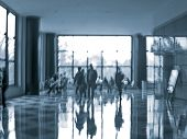 abstract image of a business people seating and walking in the lobby in intentional motion blur and
