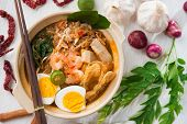 Singaporean prawn noodles or har mee. Famous Singapore food spicy fresh cooked prawn mee in clay pot