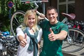 Bicycle Mechanic And Customer In Bike Store Giving Thumbs Up