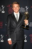 BEVERLY HILLS - JUN 16: Chandler Massey with the Outstanding Younger Actor In A Drama Series award for 'Days of Our Lives' at the 40th Annual Daytime Emmy Awards on June 16, 2013 in Beverly Hills, CA
