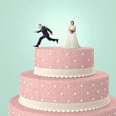 funny wedding cake with goom and bride