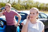 Two Drivers Making Phone Calls After Traffic Accident
