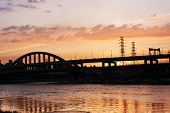Sunset cityscape with silhouette of bridge over river in Taipei, Taiwan, Asia. The bridge was named