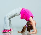 Little girl doing gymnastics exercise