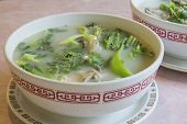 stock photo of chinese parsley  - Fish Head Soup with Chinese Vegetable Parsley Tofu and Cilantro - JPG