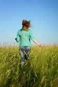 pretty young woman run away through high grass