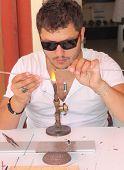 A Turkish male making glass ornaments