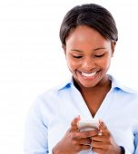 Business woman texting on her mobile phone - isolated over white