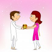 stock photo of rakshabandhan  - Brother giving gift to his sister - JPG