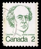 CANADA - CIRCA 1972: A stamp printed in Canada shows a portrait of Canadian Prime Minister Sir Wilfrid Laurier, circa 1972.