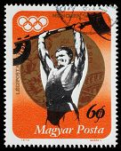 HUNGARY - CIRCA 1973: A stamp printed in Hungary, shows Weightlifting and Gold medal, with inscription