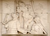 picture of fire brigade  - Art Deco bas relief sculpture showing fire fighters directing hoses at a blaze - JPG