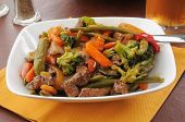 picture of snow peas  - A bowl of beef stir fry with peas - JPG