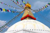 Buddhist shrine Boudhanath Stupa with Buddha wisdom eyes and praying flags in Kathmandu, Nepal