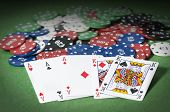 stock photo of poker hand  - Hand of poker full of aces and king with gambling chip - JPG