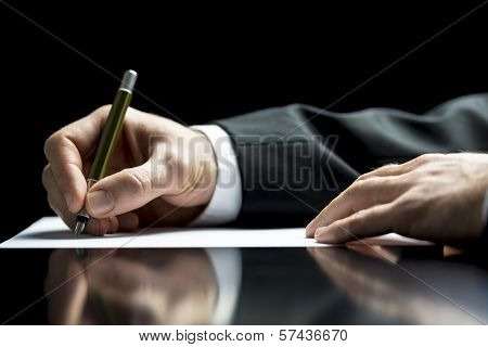 Businessman Writing A Letter Or Signing poster