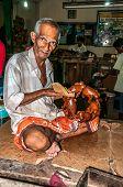 Man Makes Wooden Sculpture