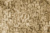 stock photo of superimpose  - Grainy and gritty background image made of letters from old newspapers superimposed on eachother - JPG