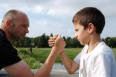 Father And Son In Wrist Fight