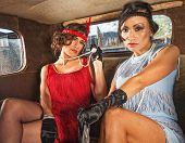 foto of gangster necklace  - Pair of charming 1920s flappers inside car - JPG