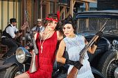 stock photo of gangster necklace  - 1920s attractive female gangsters with rifle and submachine gun