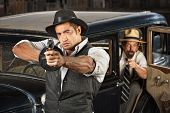 pic of tommy-gun  - 1920s vintage gangsters outside of antique automobile - JPG