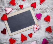 foto of heartfelt  - Chalkboard with felt hearts used as a symbol of love - JPG