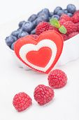 Raspberry Bilberry In White Bowls And Heart.