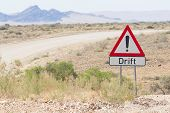 Drift Warning Sign At A Gravel Road