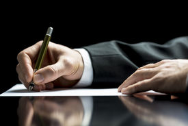 picture of counseling  - Businessman writing a letter notes or correspondence or signing a document or agreement close up view of his hand and the paper