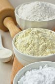stock photo of millet  - Three bowls with gluten free flour  - JPG