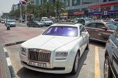 DUBAI, UAE - MARCH 31: Rolls-Royce Ghost on the street of Deira in Dubai on 31 March 2014, UAE. Duba