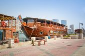 DUBAI, UAE - MARCH 31: Port Saeed along Deira's shore of Dubai Creek on 31 March 2014, UAE. Deira is an old commercial center of Dubai with small shipping and trade boats on the Dubai Creek.
