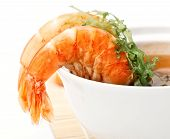 Spicy Shrimp Soup On White Background Close-up