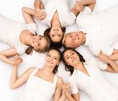 Large group of smiling teenage friends looking at camera isolated on white