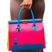 Closeup of woman with bright fashion leather neon bag. Isolated on the white studio background.