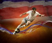 Abstract waves aroun soccer player on the national flag of Costa Rica