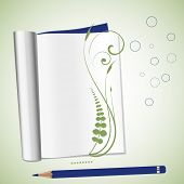 open notebook with fern and copyspace