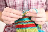 picture of knitting  - Female hands knitting with spokes close up - JPG