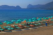 Sandy beach with parasols and beach loungers Falasarna Crete