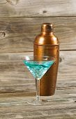Mixed Drink And Metal Mixer On Rustic Wood